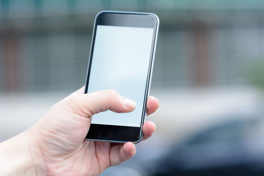 One hand holding a smartphone,Using phone.Search information with a mobile phone ,view information